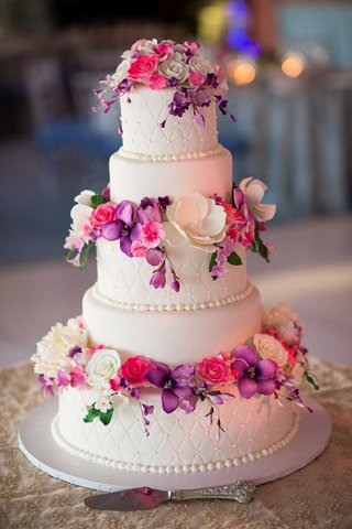 white-wedding-cake-with-purple-pink-and-white-sugar-flowers