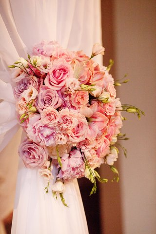 bunch-of-pink-flowers-holding-curtains-of-chuppah