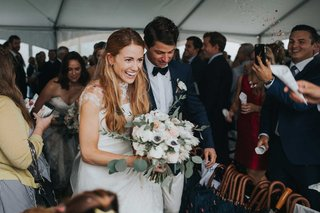 happy-bride-and-groom-confetti-toss-guests-umbrellas-white-anemone-flower-bouquet