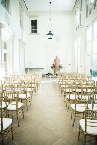 gold-chiavari-chairs-indoor-wedding-ceremony-with-fountain