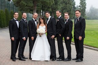 bride-in-oscar-de-la-renta-wedding-dress-groom-in-tuxedo-with-groomsmen-six-boutonnieres