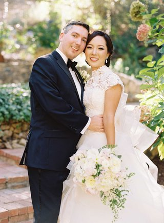 caroline-sung-in-vera-wang-wedding-dress-with-robert-bowling-in-tuxedo-on-wedding-day