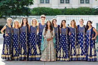 pakistani-bride-and-her-bridesmaids-dressed-in-blue-and-gold-traditional-gowns-pose