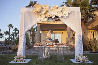 white-canopy-with-flower-decorations-over-wedding-cake-and-dessert-table-with-200-bite-size-sweets