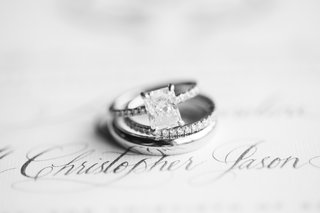 black-and-white-photo-of-engagement-ring-with-large-radiant-diamond-and-thin-pave-bands