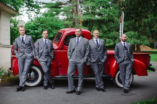 groom-in-custom-grey-brooks-brothers-suit-with-groomsmen-in-front-of-vintage-red-pickup-truck