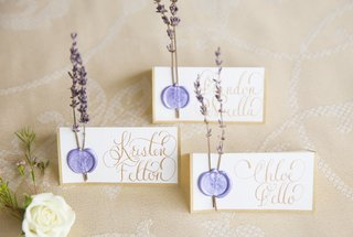 gold-calligraphy-place-cards-lavender-wax-seasls-springs-of-lavender-attached-via-wax-seal