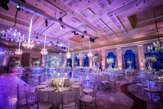 wedding-reception-at-the-breakers-with-purple-lighting-chandeliers-high-and-low-centerpieces
