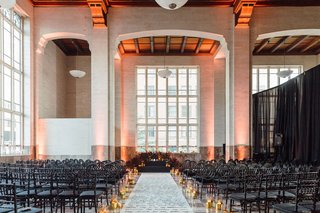 custom-aisle-runner-handwritten-words-from-poems-and-letters-candlelight-black-chairs-dark-flowers