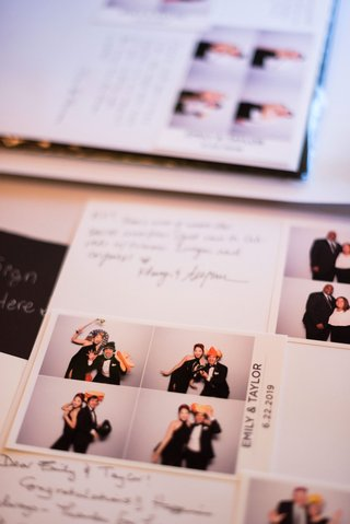 wedding-reception-guest-book-notes-from-friends-and-family-with-photo-booth-pictures-in-book