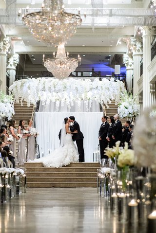 wedding-ceremony-corinthian-houston-white-flower-chandelier-crystal-chandeliers-floating-candles