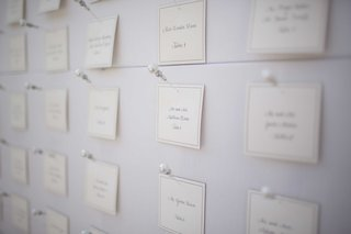 classic-place-card-escort-cards-with-pearl-and-rhinestone-pins-on-bulletin-board