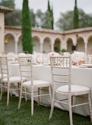 wedding-reception-white-wash-wood-chairs-white-linen-and-low-centerpiece-french-wedding-reception