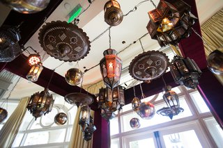 moroccan-themed-engagement-party-with-moroccan-style-lanterns-suspended-overhead