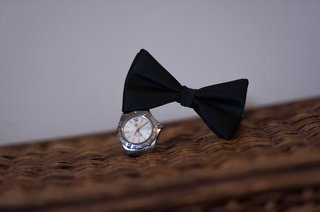 groom-accessories-black-bow-tie-and-silver-platinum-watch-for-wedding-day