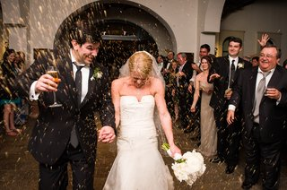 bride-and-groom-walking-through-tunnel-of-guests