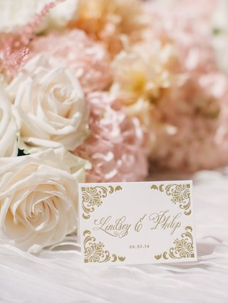 wedding-reception-table-with-ceci-new-york-place-card-with-gold-damask-print-white-roses