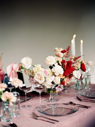 wedding-reception-pink-velvet-linen-tablecloth-pink-and-red-flowers-taper-candles-candlelight