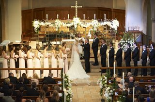 father-of-the-bride-lifting-veil-at-church-wedding