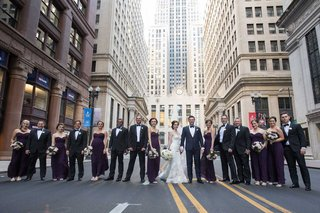 wedding-party-in-street-chicago-downtown-purple-bridesmaid-dresses-tuxedos-for-groomsmen
