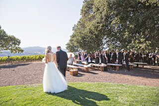 bride-in-wedding-dress-from-bella-bianca-with-father-of-bride-two-trees-outdoor-vineyard-winery