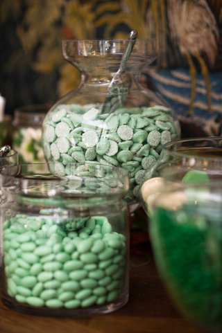 mint-green-candy-and-dessert-bar-in-apothecary-jars-at-wedding