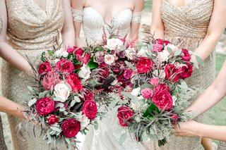 bridesmaids-in-sequin-gold-bouquets-in-deep-magenta-and-pink-feminine-fall-wedding-colors