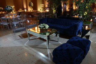 dimly-lit-lounge-space-navy-couch-reflective-dominican-republic-wedding-ballroom-hotel-reception