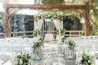 calamigos-ranch-wedding-outdoor-wedding-with-waterfall-chuppah-under-wooden-structure