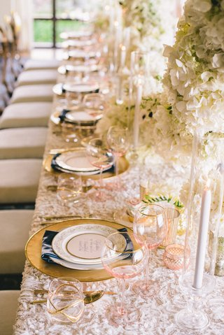 wedding-reception-place-setting-with-wine-glasses-with-pink-bowls-and-double-old-fashioned-glass