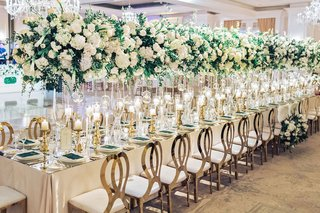 wedding-reception-table-long-gold-chairs-tall-centerpieces-ballroom-wedding