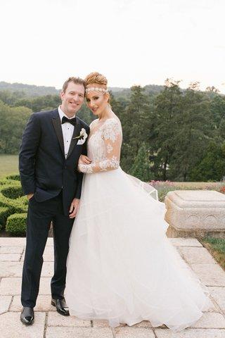 bride-in-hayley-paige-headpiece-groom-in-ike-behar