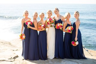 bride-bridesmaids-navy-colorful-bouquets-seaside-cliff-side-buns-beachy-wedding-california