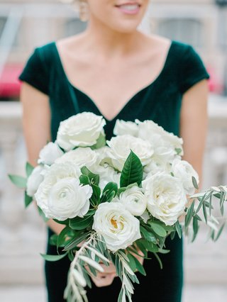 bridesmaid-in-velvet-emerald-green-dress-holding-ivory-bouquet-with-garden-rose-and-ranunculus