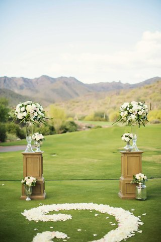 silverleaf-club-wedding-ceremony-with-flower-petal-scroll-design-aisle-and-soft-flower-arrangements