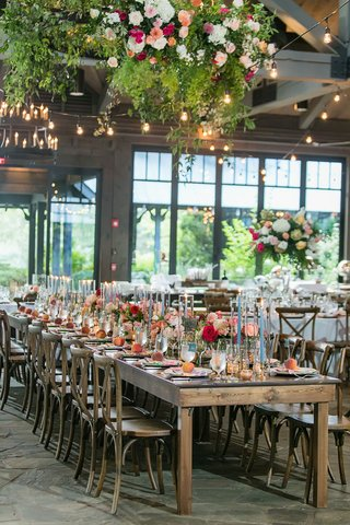 wedding-reception-old-edwards-inn-wood-tables-pink-orange-flower-centerpiece-bistro-lights