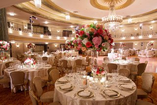wedding-reception-decor-ballroom-with-pink-and-red-flowers-gold-detailing