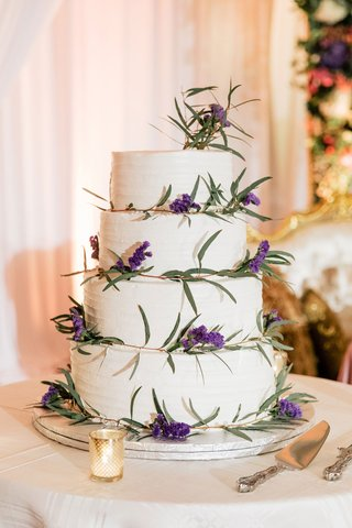 wedding-cake-four-layer-buttercream-frosting-fresh-greenery-and-purple-lavender-flowers-cake-server