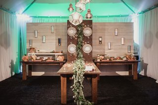 wedding-reception-food-station-with-table-that-appears-to-climb-wall