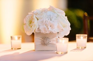 square-vase-with-crystal-embellishment-white-roses-and-hydrangeas-votive-candles