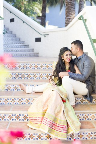 south-asian-wedding-inspiration-bride-in-lehenga-bride-and-groom-on-tiled-stairs