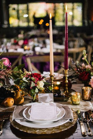 rustic-wine-colored-old-europe-themed-tablescape-with-dark-candles-and-deep-florals-gold-plates