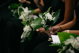 bridesmaid-bouquets-with-tropical-leaves-ferns-white-flowers