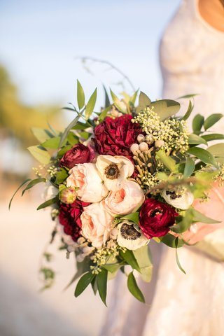 wedding-bridal-bouquet-with-garden-rose-red-burgundy-ranunculus-flowers-greenery-and-brunia