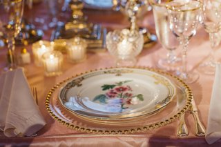 gold-rimmed-glassware-and-floral-china-plate