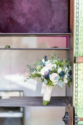 white-rose-bouquet-with-greenery-and-blue-elements-white-ribbon-stems