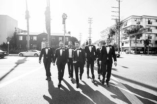 black-and-white-photo-of-groom-in-lanvin-tuxedo-and-groomsmen-walking-across-the-street