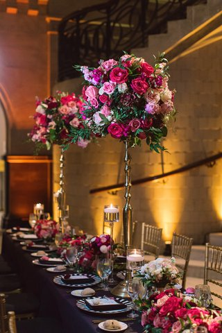 tall-centerpiece-on-skinny-gold-stand-round-arrangement-of-magenta-florals