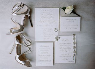 wedding-invitation-with-gold-calligraphy-wedding-jewelry-and-silver-jimmy-choo-wedding-heels