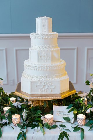 wedding-reception-stand-cake-on-gold-stand-white-cake-greenery-candle-votive-wedding-cake-with-dairy